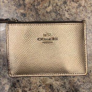 Coach gold coin purse